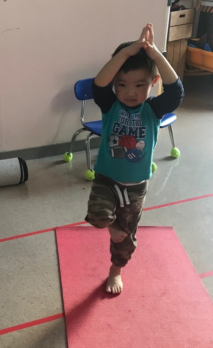 Captain Hunt PK student practices yoga