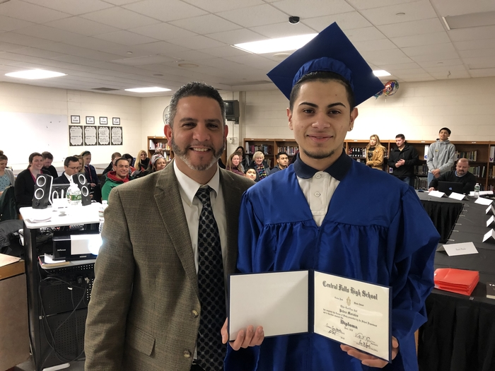 Pablo Morales picks up his hard-earned diploma